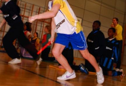 School pupils taking part in a inter school indoor athletics event London UK